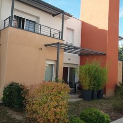 Apt-maison T4 avec garage et jardin privatif