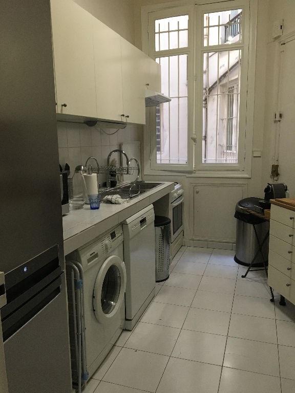 Location appartement Paris 4ème 4472€ CC - Photo 10