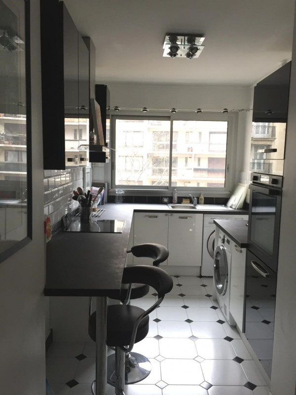 Location appartement Paris 17ème 2 364€ CC - Photo 4
