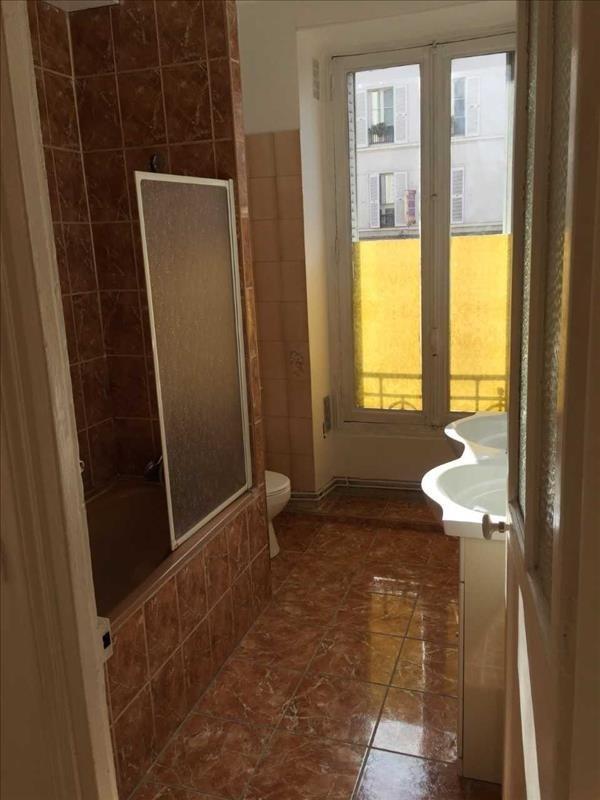 Locação apartamento Paris 18ème 1290€ CC - Fotografia 2