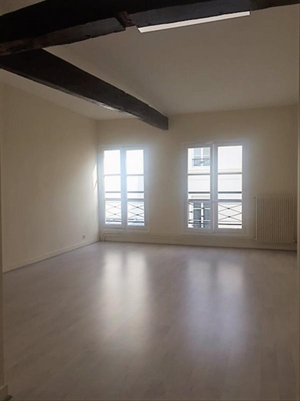 Location appartement Paris 9ème 2 750€ CC - Photo 4