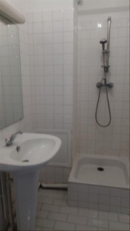 Location appartement Paris 18ème 1 921€ CC - Photo 8