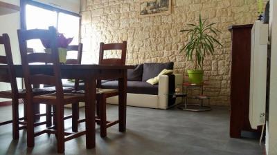 Appartement 60 m² rez-de-chaussée