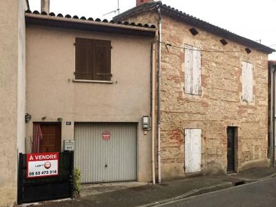 Maison de ville en pierre F4/5 avec garage et jardinet