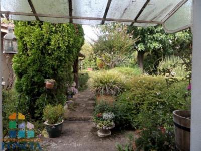 Maison de ville d'environ 170m² habitable avec superbe jardin