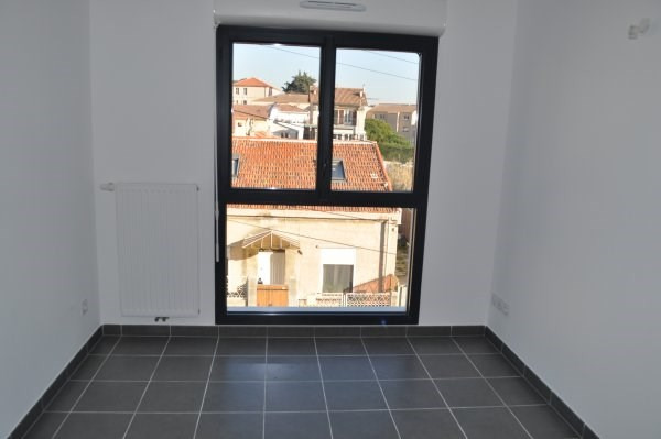 Location appartement Marseille 16ème 720€ CC - Photo 4