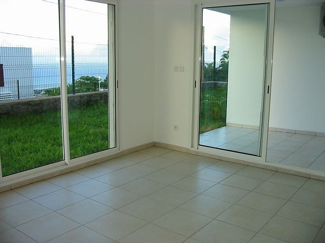 Location appartement Ste clotilde 561€ CC - Photo 5