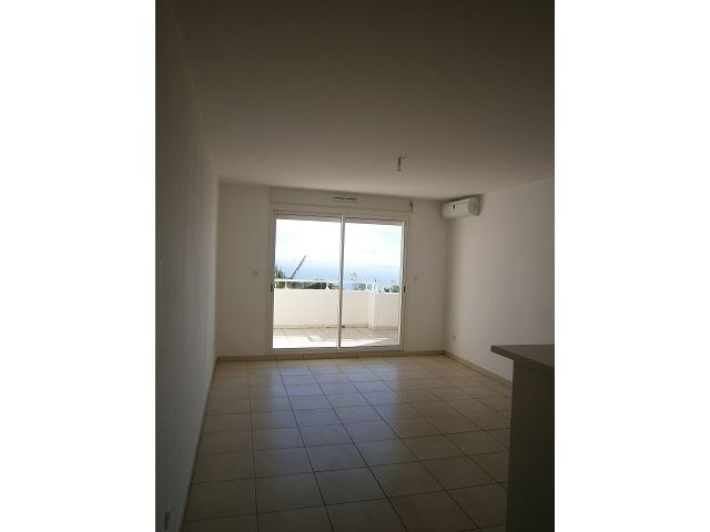 Location appartement Ste clotilde 371€ CC - Photo 3
