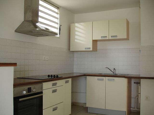 Location appartement Ste clotilde 898€ CC - Photo 7