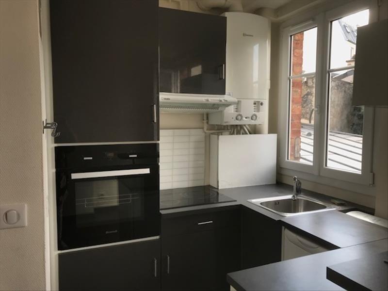 Locação apartamento Paris 18ème 957€ CC - Fotografia 6