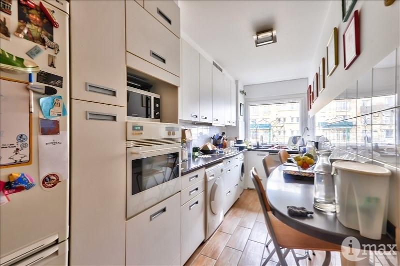 Vente de prestige appartement Paris 18ème 1050000€ - Photo 8
