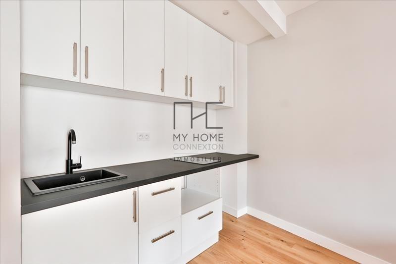 Venta  apartamento Paris 18ème 437800€ - Fotografía 4