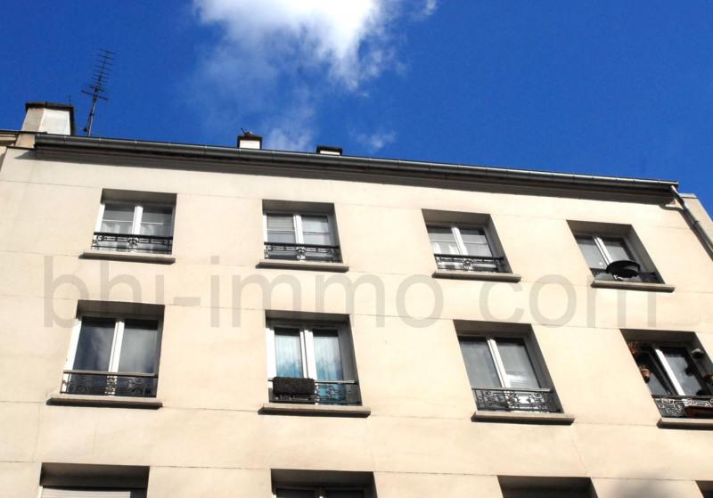 Location appartement Paris 18ème 610€ CC - Photo 8