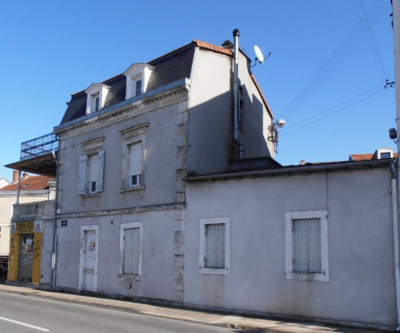 Immeuble 2 appartements et local commercial