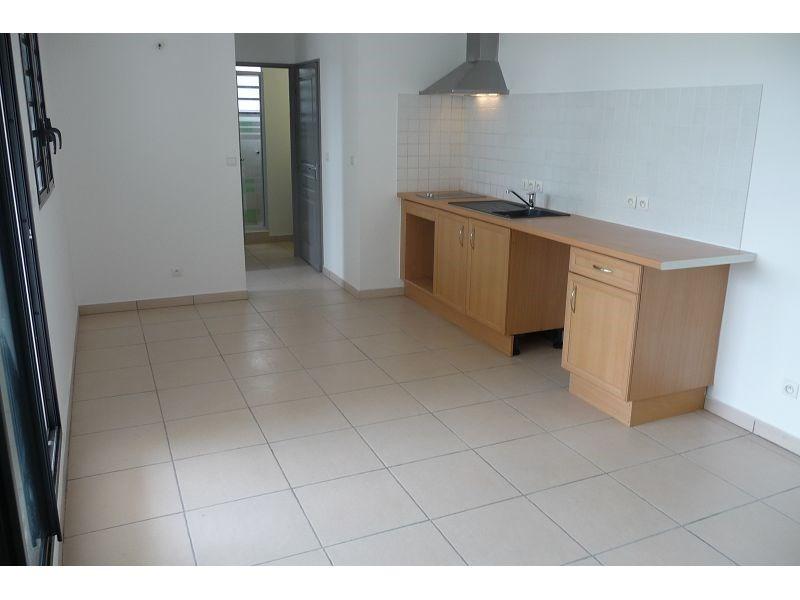 Location appartement La possession 511€ CC - Photo 2
