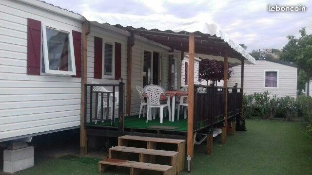 Mobilhome 8 couchages 44 M2 3 Chambres, 2 salle de bains, 2 WC, Terrasse couverte salon de jardin