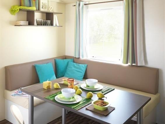 Le Camping** de la Prairie à Port en Bessin vous propose la location de mobil-homes avec tout le confort nécessaire à...