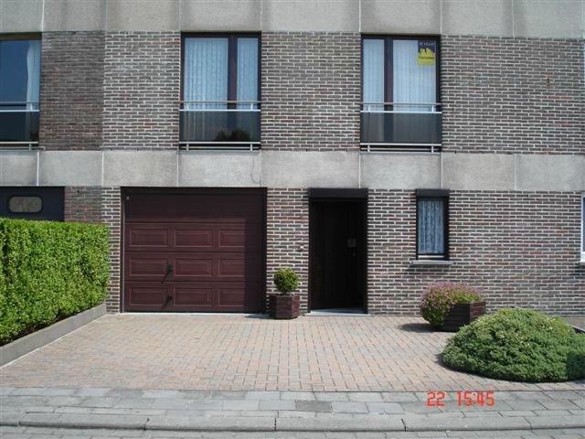 Maison spacieuse et confortable avec garage et petit jardin