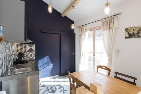 à l'étage, cuisine et acces terrasse