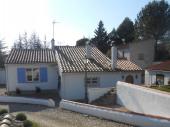Maison avec trois chambres
