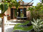 Maison avec jardin au calme 2 chambres climatisées draps et linge de toilette fournis +internetproche commercesplages