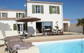 House with a pool near the beach
