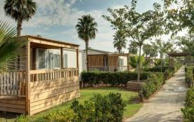 Profitez de votre séjour dans un bungalow au bord de mer. La proximité du centre de planche à voi...