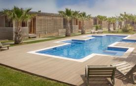 Profitez de votre séjour dans l'un de ces bungalows en bois exclusifs, situé dans un jardin privé...