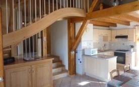 Appartement situé au premier étage d'une maison comprenant également un autre logement de vacances.