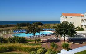 Appartement C105 tout confort dans résidence bord de mer avec piscines chauffées