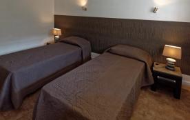 chambre avec deux lit rapprochables