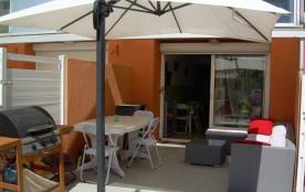 Centre et plage, appartement T3 en rez de jardin.