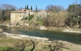 Un ancien moulin à eau en pierre,bâti sur une propriété magnifiquement fleurie de 6 hectares,vous...