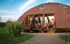 Maison en bois ronde qui tourne