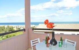 Résidence Horizon sur Mer - Appartement studio cabine avec salon de jardin et vue mer.