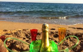 Des clients heureux... champagne à la plage...