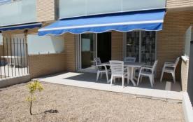 BEL APPARTEMENT avec terrasse et jardin, PISCINE et PADDLE communs, à Benicarlo
