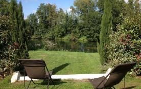 Jardin derrière qui donne sur la rivière