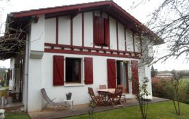 façade arrière et salon de jardin