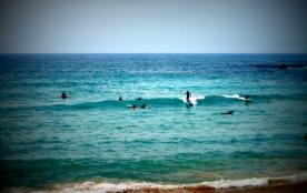 Surf sur la plage de la Milady