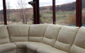 Véranda Vue sur montagne Canapé d'angle en cuir 1 place relaxation Table salon
