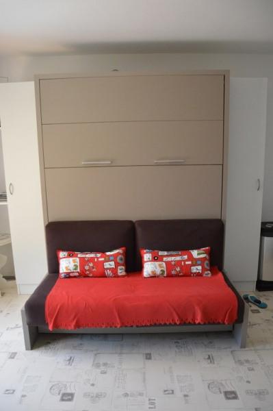 canapé et lit escamotable neuf de grande qualité
