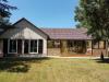5pièces - 121 m² Au calme, plain pied ossature bois en excellent état d'entretien sur terrain arboré de 1600 m², ...