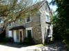 7pièces - 165 m² ENSEMBLE IMMOBILIER composé d'une maison d'habitation en pierres à finir de rénover, vaste garage ...