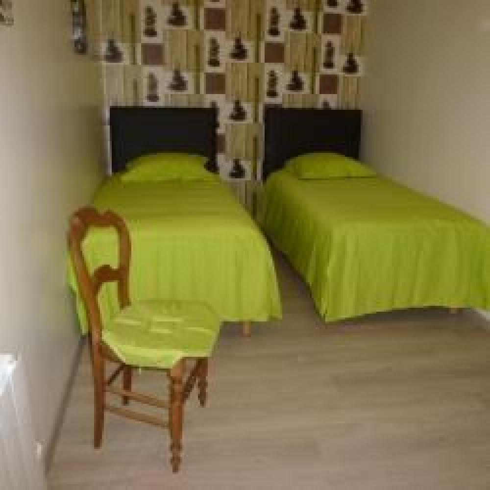 Chambre zen 3 lits à l'étage