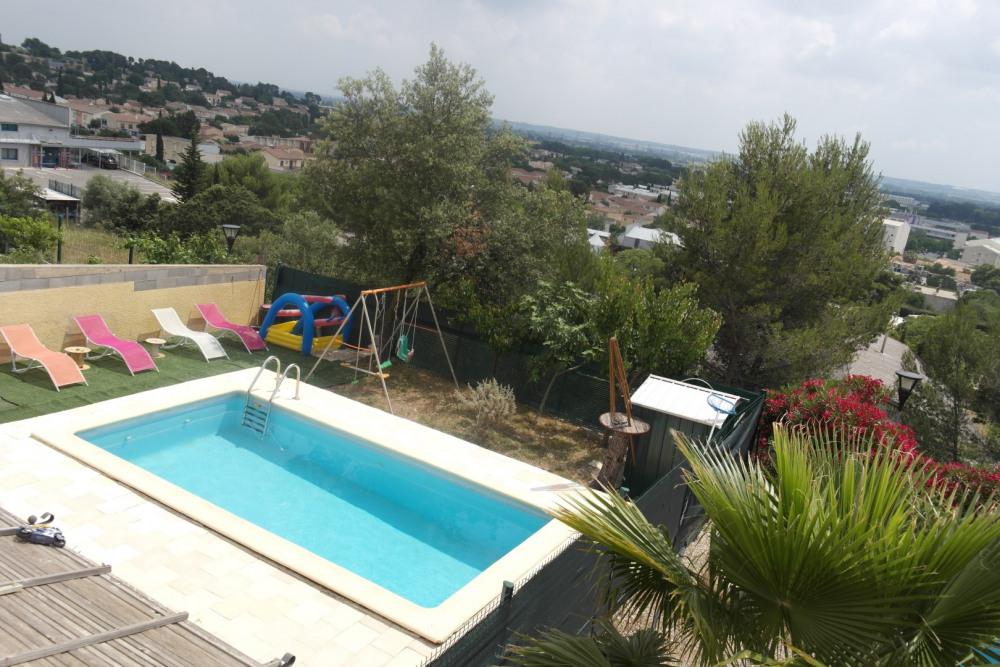 VILLA AVEC PISCINE dans un  quartier calme proche hôtel Vatel et chu de Nîmes