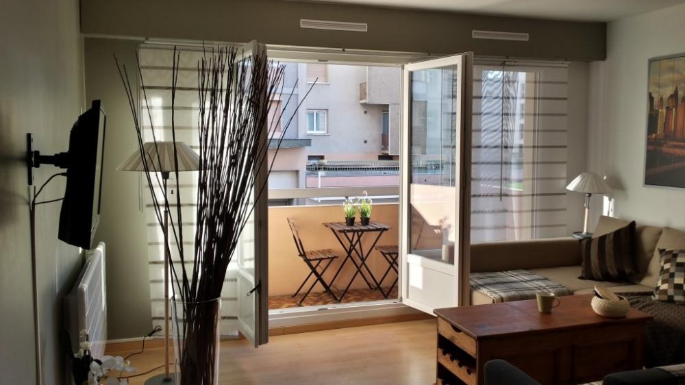 Salon / Salle-à-manger - balcon aménagé
