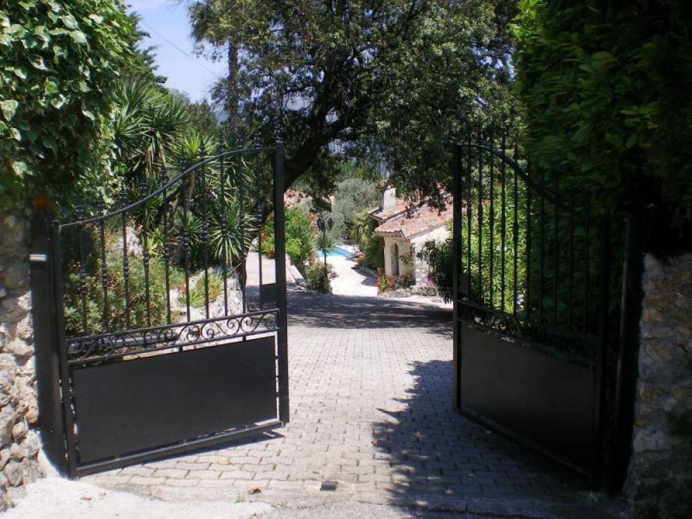 The main electric gates to the private villa
