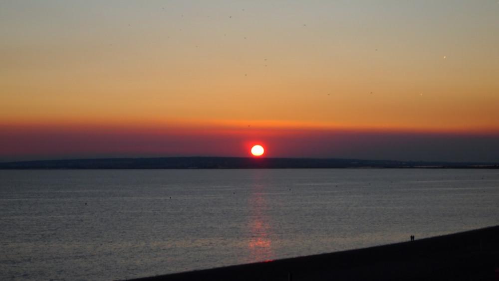 de la terrasse le coucher du soleil