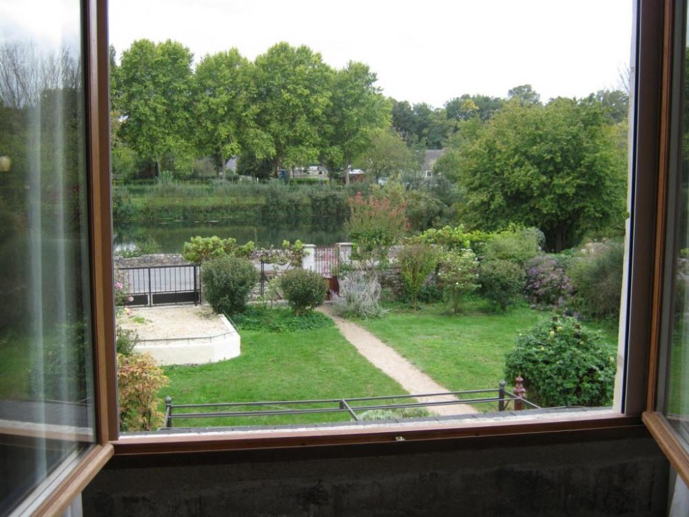 Chambre à l'étage avec vue sur la rivière